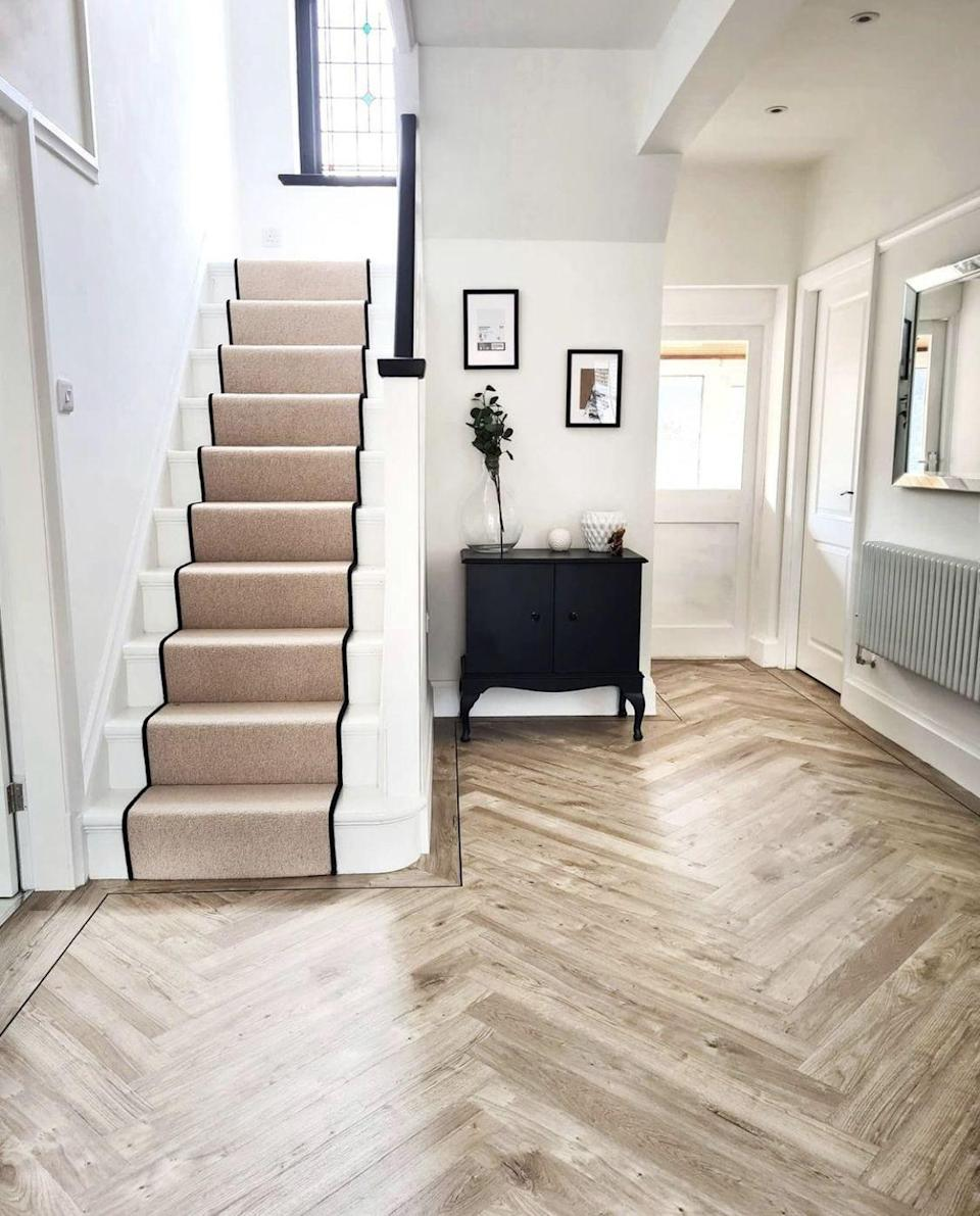 """<p>Showcase subtle textures on your stairs with a neutral runner. We've got our eye on this design, which has a chic finish thanks to its neat black trim. Go on, give your hallway the upgrade it deserves...</p><p>Pictured: <a href=""""https://www.cormarcarpets.co.uk/"""" rel=""""nofollow noopener"""" target=""""_blank"""" data-ylk=""""slk:Bouclé Neutrals in Kensington Oak, Comar Carpets"""" class=""""link rapid-noclick-resp"""">Bouclé Neutrals in Kensington Oak, Comar Carpets</a></p>"""