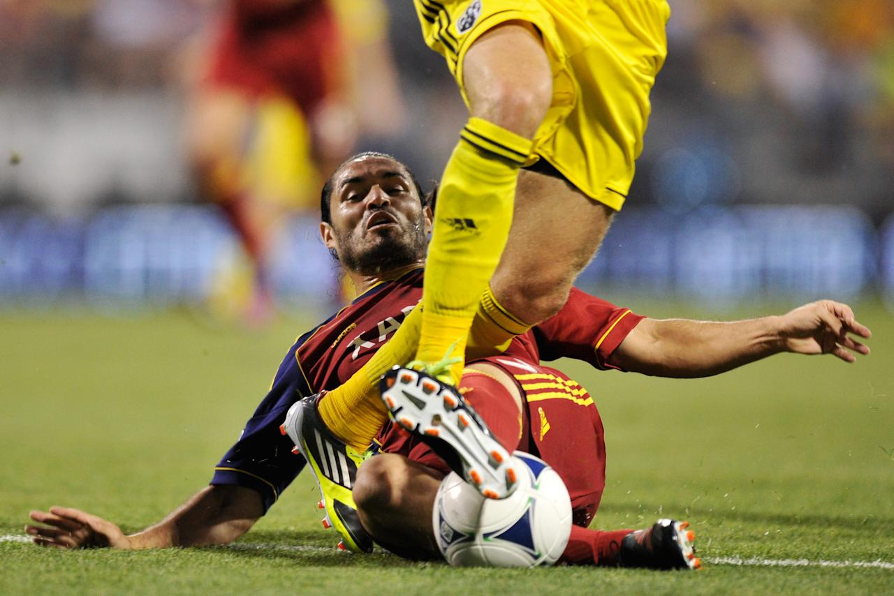 COLUMBUS, OH - JUNE 30: Fabian Espindola #7 of Real Salt Lake slides in for a tackle on the Columbus Crew in the first half on June 30, 2012 at Crew Stadium in Columbus, Ohio. (Photo by Jamie Sabau/Getty Images)