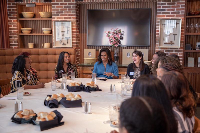 Michelle Obama surrounded by members of my HTX Book and Brunch club. (Photo: Courtesy of Isaac Palmisano)