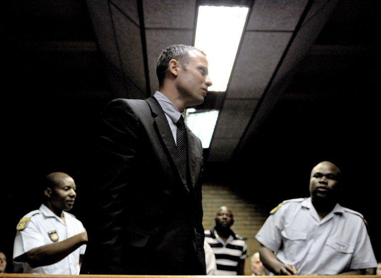 Oscar Pistorius leaves the court room on February 15, 2013 at the Magistrate Court in Pretoria