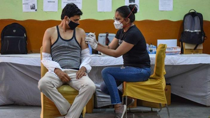 A health worker administers a dose of Covid vaccine to a beneficiary, at a Vaccination centre in Inderpuri, on June 4, 2021 in New Delhi, India.