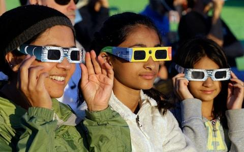 eclipse glasses - Credit: AP