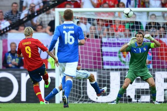 GDANSK, POLAND - JUNE 10: Fernando Torres of Spain chips the ball over Gianluigi Buffon of Italy during the UEFA EURO 2012 group C match between Spain and Italy at The Municipal Stadium on June 10, 2012 in Gdansk, Poland. (Photo by Shaun Botterill/Getty Images)