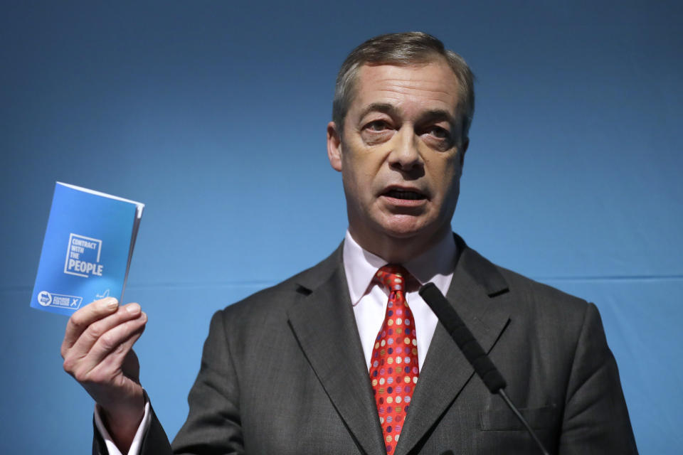"""Nigel Farage's, leader of Britain's Brexit Party, holds his """"Contract with the People"""", prior to his speech at the launch of the party's policies for the General Election campaign, in London, Friday, Nov. 22, 2019. Britain goes to the polls on Dec. 12. (AP Photo/Kirsty Wigglesworth)"""