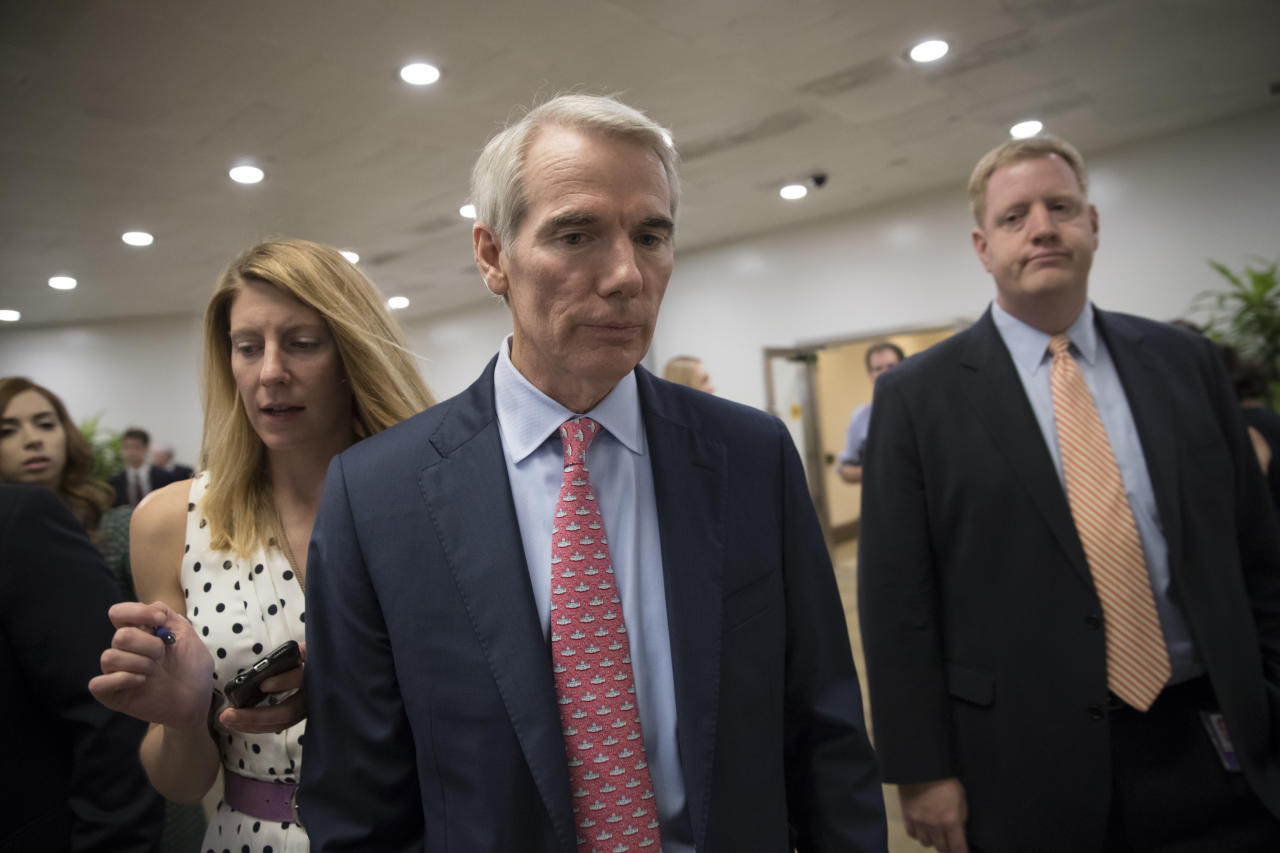 FILE- In this July 20, 2017, file photo, Sen. Rob Portman, R-Ohio, heads to the chamber for a vote, on Capitol Hill in Washington. President Donald Trump is scheduled to visit Ohio on Tuesday, July 25, as the U.S. Senate could vote on beginning debate on a Republican health care bill. Portman could be a key swing vote on the legislation and is facing immense pressure from both sides as he makes his decision. (AP Photo/J. Scott Applewhite, File)