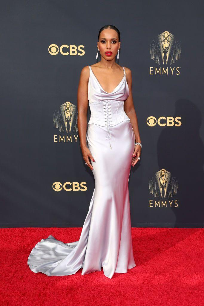 <p>It was a slinky, silky slip dress for Kerry Washington, who chose a custom design by Etro for the big night, which featured a visible corset belt and cowl neck. The actress paired the silver frock with a bright red lip, a slick ponytail and some earrings by De Beers.</p>