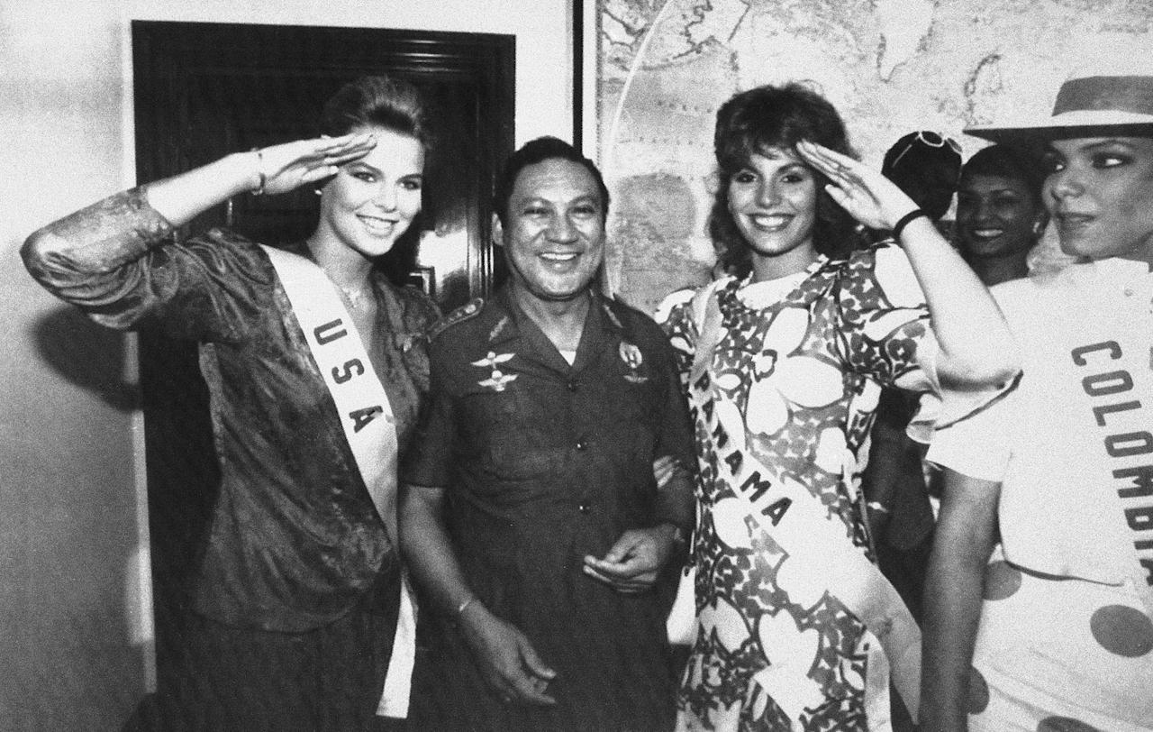 <p>Miss USA Christy Fichtner, left, and Miss Panama Gilda Garcia Lopez, salute while flanking Gen. Manuel Antonio Noriega in Panama City on July 5, 1986. Pictured at right is Miss Colombia Maria Monica Urbina. (AP Photo/Jim Ellis) </p>