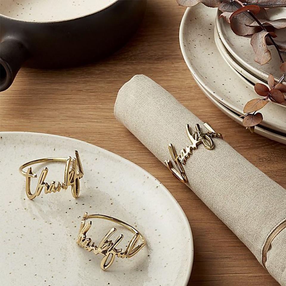 "<p><strong>   </strong></p><p>crateandbarrel.com</p><p><strong>Out of Stock</strong></p><p><a rel=""nofollow"" href=""https://www.crateandbarrel.com/thankful-napkin-ring/s585007"">Shop Now</a></p><p>Spell out the sentiment of the day. These 100% brass Thanksgiving napkin rings are a refined addition to the holiday table, and they're a stylish accessory <a rel=""nofollow"" href=""https://www.myrecipes.com/holidays-and-occasions/things-you-need-to-host-thanksgiving"">for first-time Turkey Day hosts</a> to set out.</p>"