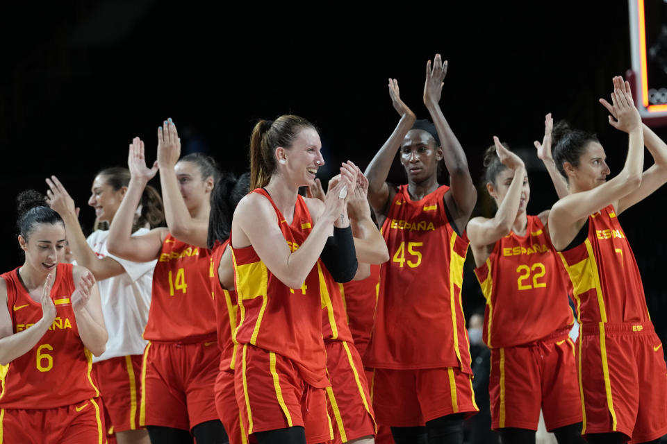 Spain players celebrate their win in the women's basketball preliminary round game against Canada at the 2020 Summer Olympics, Sunday, Aug. 1, 2021, in Saitama, Japan. (AP Photo/Eric Gay)