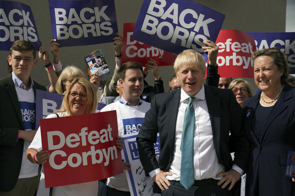 Britain's Conservative Party leadership contender Boris Johnson backed-up by supporters during a party leadership hustings in Darlington, England, Friday July 5, 2019.  The two contenders, Jeremy Hunt and Boris Johnson are competing for votes from party members, with the winner replacing Prime Minister Theresa May as party leader and Prime Minister of Britain's ruling Conservative Party. ( Owen Humphreys/PA via AP)
