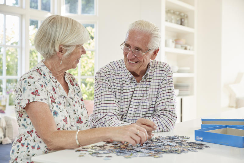 Senior couple doing a puzzle