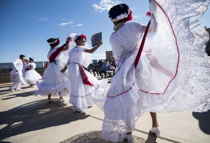 <p>Dancers with the Mexico Vivo group prepares to perform at the East Las Vegas Community Center, an early voting location, in Las Vegas on Saturday, Oct. 20, 2018, the first day of early voting in Nev. (Photo: Bill Clark/CQ Roll Call/Getty Images) </p>