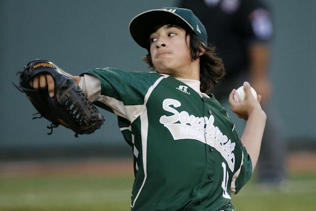 Pearland pitcher Clayton Broeder delivers during the first inning of a baseball game against Philadelphia at the Little League World Series tournament in South Williamsport, Pa., Sunday, Aug. 17, 2014. (AP Photo/Gene J. Puskar)