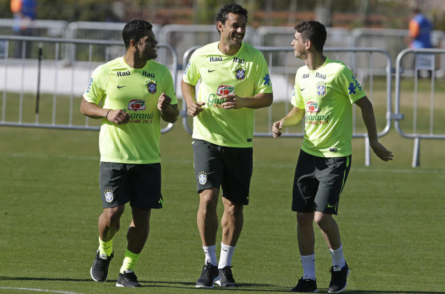 Brazil's players Hulk, from left, Fred, and Oscar, jog during a training session in Teresopolis, Brazil, Wednesday, June 25, 2014. Brazil will face Chile on June 28 in the round of 16 of the 2014 soccer World Cup. (AP Photo/Andre Penner)