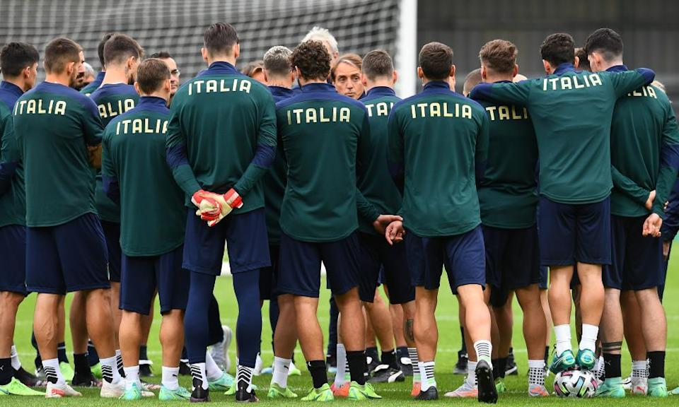 Roberto Mancini (centre) talks to his Italy squad in training at Barnet on Monday.