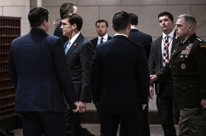 Secre­tary of Defen­se Mark Esper, left, and Gen. Mark Milley, chair­man of the Joint Chief­s of Staff, arrive for a closed briefing with members of the House in Washington, Jan. 8, 2020. (Anna Moneymaker/The New York Times)