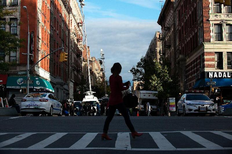 A woman walks past West 147th street on October 23, 2014 in New York City