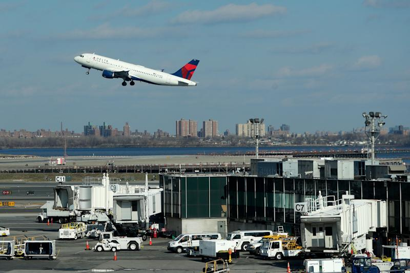"An Delta Airlines jet takes off from LaGuardia Airport, Friday, Jan. 25, 2019, in New York. New York Gov. Andrew Cuomo says delays at East Coast airports amid a partial federal government shutdown are another symptom of the ""federal madness"" caused by Republican President Donald Trump. Earlier Friday, the FAA announced LaGuardia Airport and Newark Liberty International Airport in New Jersey were both experiencing delays in takeoffs due to staffing problems at two air traffic control facilities. (AP Photo/Julio Cortez)"