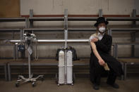 An ultra-Orthodox Jewish man rests after receiving his second dose of the Pfizer COVID-19 vaccine at a coronavirus vaccination center set up at a synagogue in Bnei Brak, Israel, Sunday, March. 7, 2021. (AP Photo/Oded Balilty)