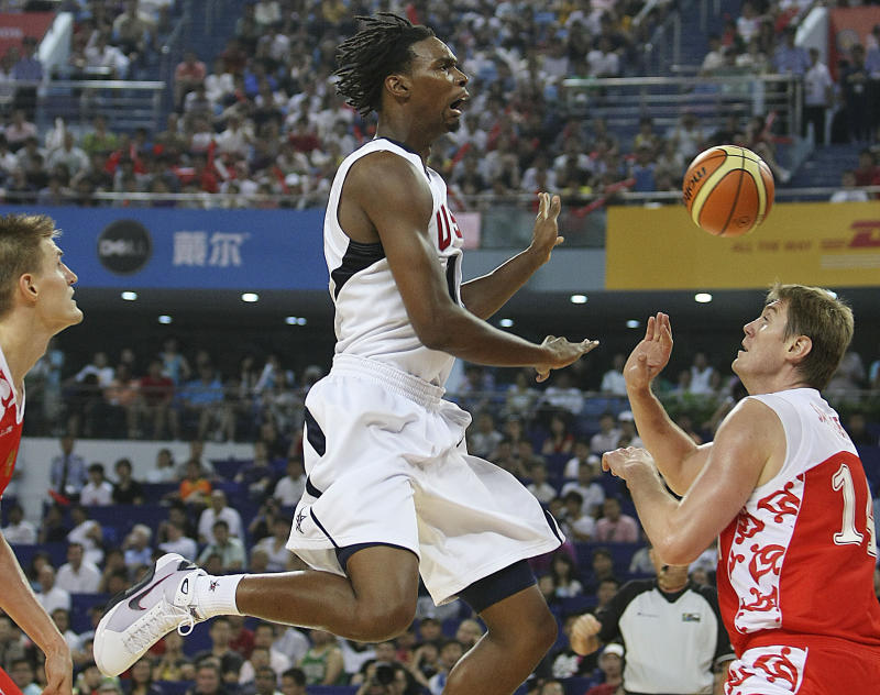 Chris Bosh of USA men's basketball team for the Beijing 2008 Olympics reacts after missing to score during a match between USA and Russia as a warm-up for Olympics at the USA Basketball International Challenge tournament in Shanghai Sunday Aug. 3, 2008. US won 89-68.