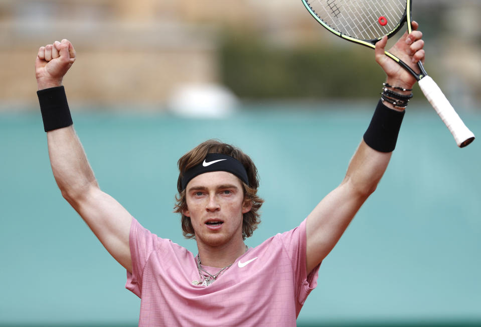 Andrey Rublev of Russia celebrates after defeatin Casper Ruud of Norway during their semifinal match of the Monte Carlo Tennis Masters tournament in Monaco, Saturday, April 17, 2021. (AP Photo/Jean-Francois Badias)