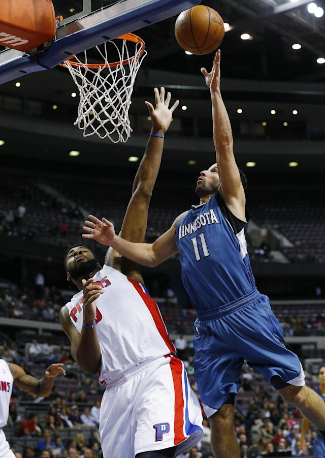 Minnesota Timberwolves point guard J.J. Barea (11) shoots over Detroit Pistons center Andre Drummond in the first half of their preseason NBA basketball game in Auburn Hills, Mich., Thursday, Oct. 24, 2013. (AP Photo/Paul Sancya)