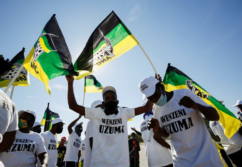 Supporters of former South African President Zuma sing and dance in front of his home following his sentencing, in Nkandla