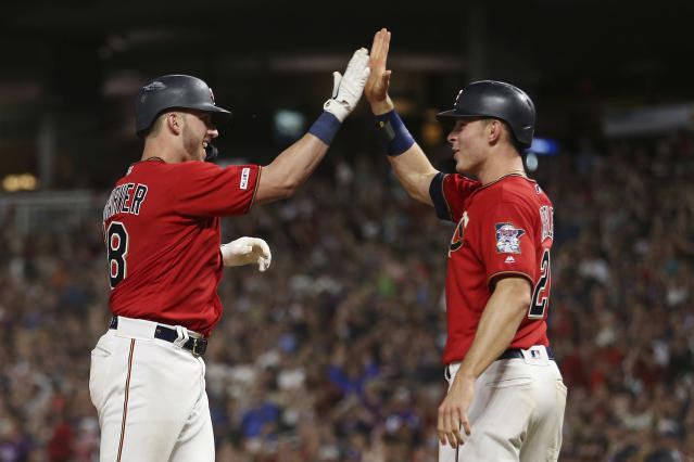 Minnesota Twins' catcher Mitch Garver high-fives teammate Max Kepler after Garver hit a home run against the Kansas City Royals during the eighth inning of a baseball game Friday, June 14, 2019, in Minneapolis. Minnesota won 2-0. (AP Photo/Stacy Bengs)