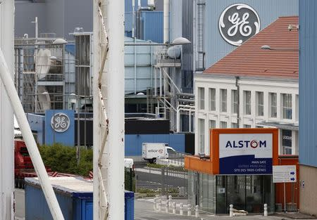 The logos of French power and transport engineering company Alstom and US conglomerate General Electric are pictured on their site in Belfort