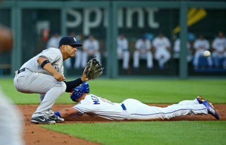 May 18, 2018; Kansas City, MO, USA; Kansas City Royals second baseman Whit Merrifield (15) slides into second base ahead of the tag by New York Yankees second baseman Gleyber Torres (25) in the third inning at Kauffman Stadium. Mandatory Credit: Jay Biggerstaff-USA TODAY Sports