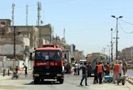 Central Baghdad blasts kill at least 18: police