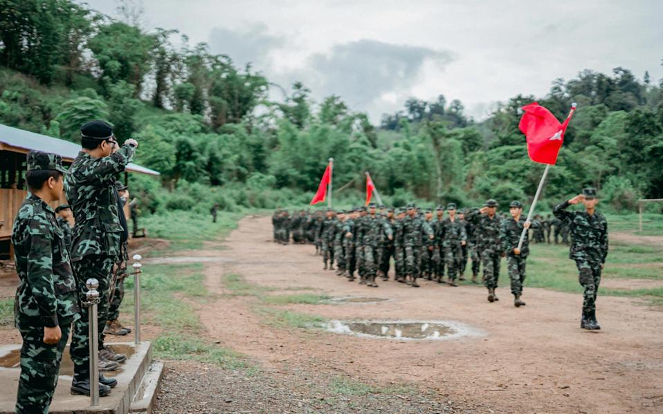 soldiers from the People's Defence Force (PDF) standing in formation