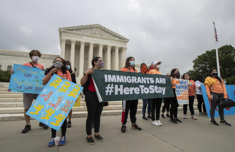 Deferred Action for Childhood Arrivals (DACA) students celebrate in front of the Supreme Court after the Supreme Court rejected President Donald Trump's effort to end legal protections for young immigrants, Thursday, June 18, 2020, in Washington. (Manuel Balce Ceneta/AP Photo)
