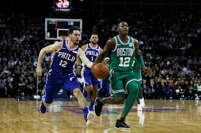 Basketball - NBA - Boston Celtics vs Philadelphia 76ers - O2 Arena, London, Britain - January 11, 2018 Boston Celtics' Terry Rozier in action with Philadelphia 76ers' T J McConnell REUTERS/Matthew Childs