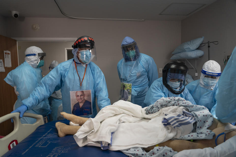 Dr Joseph Varon (2nd left) supervises the handling of a patient after death in the Covid-19 intensive care unit. Source: Getty