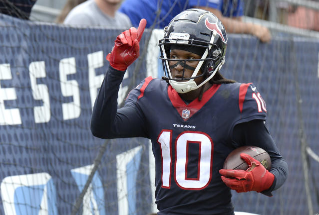 Houston Texans wide receiver DeAndre Hopkins celebrates after scoring a touchdown on a 28-yard play against the Tennessee Titans in the first half of an NFL football game Sunday, Sept. 16, 2018, in Nashville, Tenn. (AP Photo/Mark Zaleski)