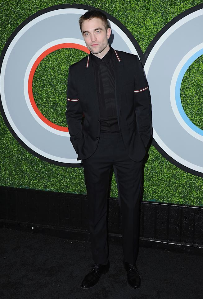 <p>The actors looked slick in an all-black suit, trimmed with red and white stripes. <em>[Photo: Getty]</em> </p>