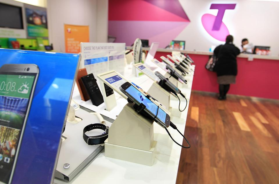 SYDNEY, AUSTRALIA – JULY 24: Mobile phones products and consumer telecommunications technology on display in a Telstra retail store in Sydney on July 24, 2014 in Sydney, Australia. (Photo by James Alcock/Getty Images)