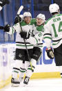 Dallas Stars center Joe Pavelski (16) and left wing Roope Hintz (24) celebrate a goal by Pavelski during the second period of an NHL hockey game against the Tampa Bay Lightning, Friday, May 7, 2021, in Tampa, Fla. (AP Photo/Jason Behnken)