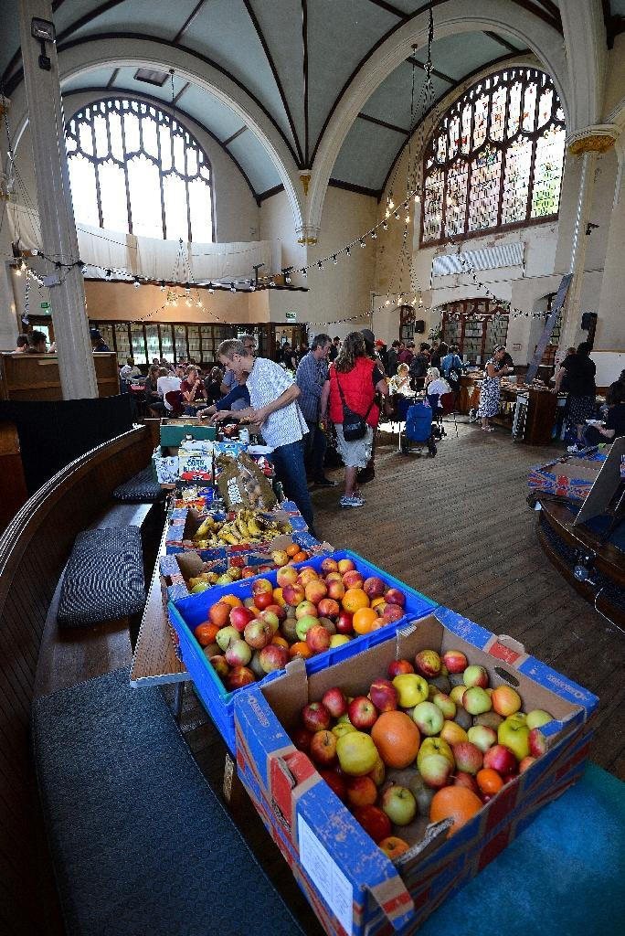 Food on display at a Real Junk Food Project (RJFP) cafe in a church in Brighton, southeast England, on September 11, 2015 (AFP Photo/Glyn Kirk)