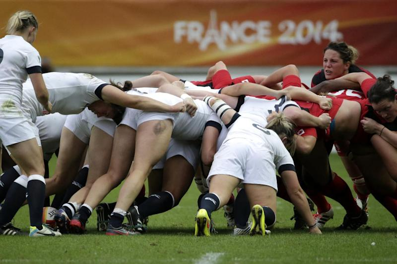 England and Canada vie for the ball in a scrum during the IRB Women's Rugby World Cup final match between England and Canada at the Jean Bouin Stadium in Paris on August 17, 2014
