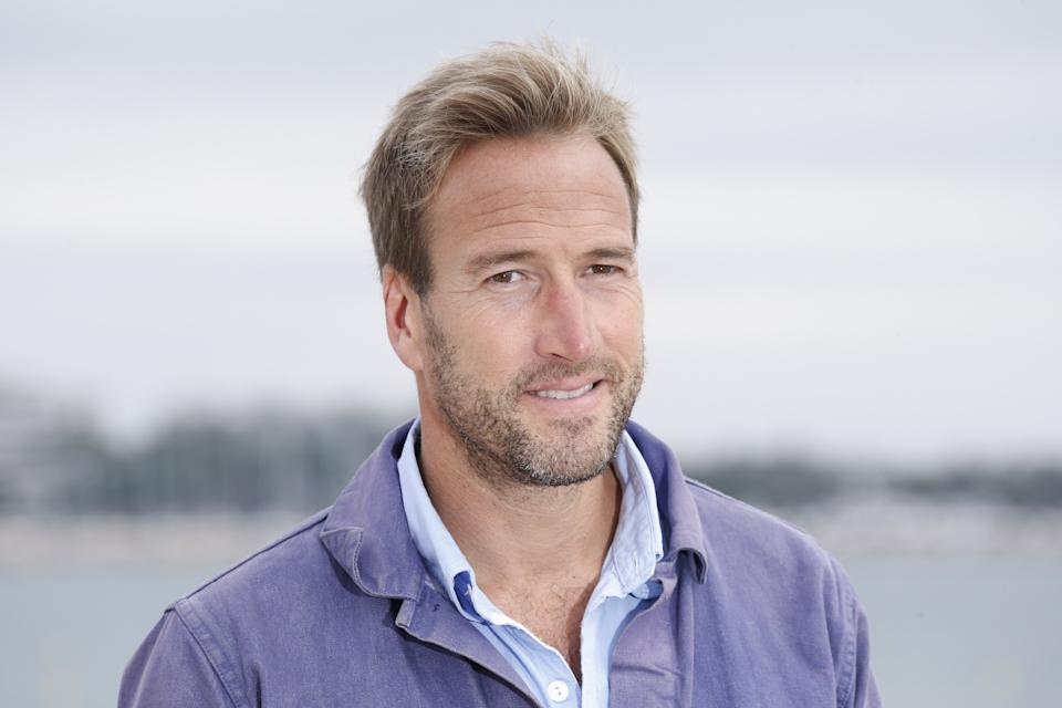 """British writer Ben Fogle poses during a photocall for the TV show """"The big catch"""" at the MIPCOM audiovisual trade fair in Cannes, southeastern France, on October 6, 2015. Held each year on the French Riviera, the audiovisual trade fair brings together the movers and shakers of the global entertainment business to network, talk shop and buy, sell and finance new content. AFP PHOTO / VALERY HACHE        (Photo credit should read VALERY HACHE/AFP/Getty Images)"""