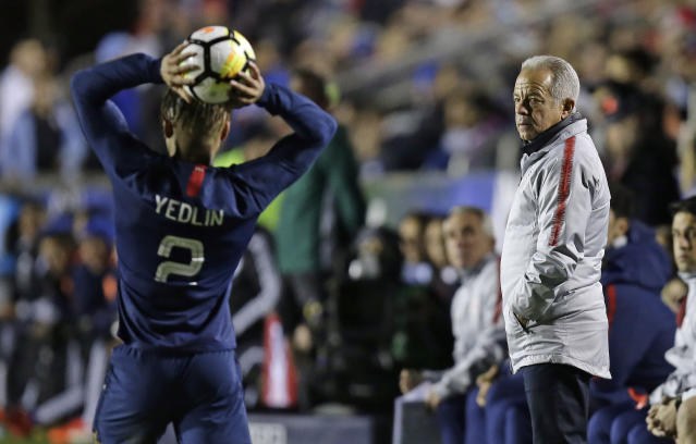 United States Dave head coach Sarachan watches DeAndre Yedlin (2) inbound the ball during the second half of an international friendly soccer match against Paraguay in Cary, N.C., Tuesday, March 27, 2018. United States won 1-0. (AP Photo/Gerry Broome)