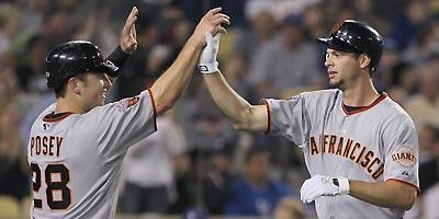 Brandon Belt (right) and Buster Posey give the Giants a bright future