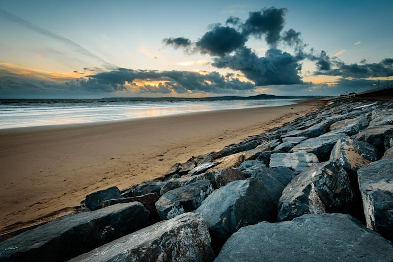 Storm clouds at sunset on Aberavon beach, Wales, UK