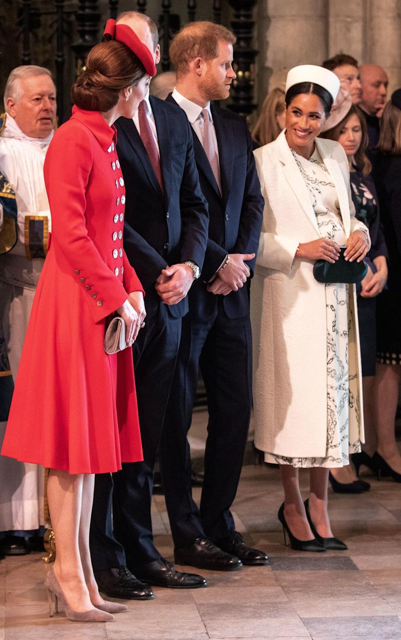 The duchesses chatting at the Commonwealth service.  (Photo: RICHARD POHLE via Getty Images)