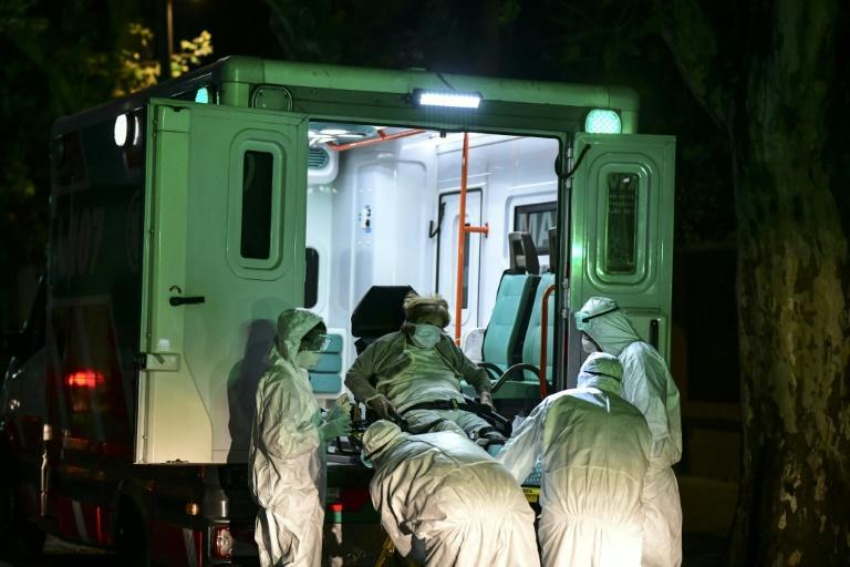 An elderly patient believed to be infected with Covid-19 is taken from a nursing home in Buenos Aires, Argentina in April 2021