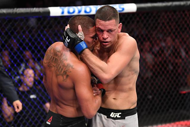(R-L) Nate Diaz and Anthony Pettis embrace after their welterweight bout during the UFC 241 event at the Honda Center on August 17, 2019 in Anaheim, California. (Getty Images)