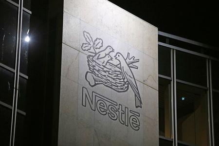 The Nestle logo is pictured on the company headquarters building in Vevey