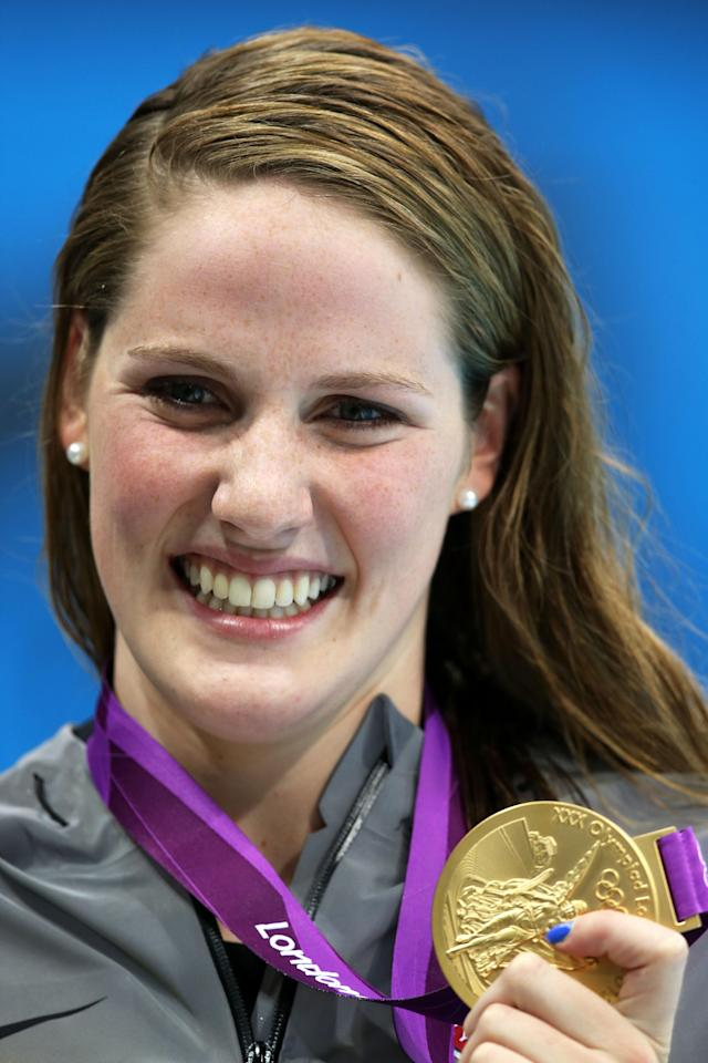 LONDON, ENGLAND - JULY 30: Missy Franklin of the United States celebrates with her gold medal during the medal ceremony for the Women's 100m Backstroke on Day 3 of the London 2012 Olympic Games at the Aquatics Centre on July 30, 2012 in London, England. (Photo by Clive Rose/Getty Images)